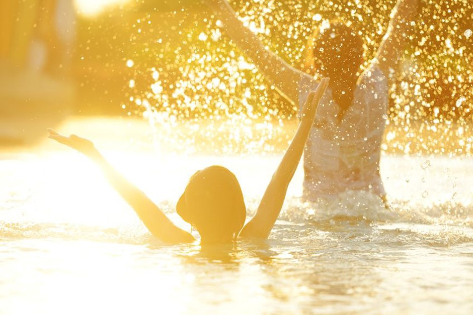 spalshing water woman mom summer lake golden hour inspiration_123rf_15640193_m