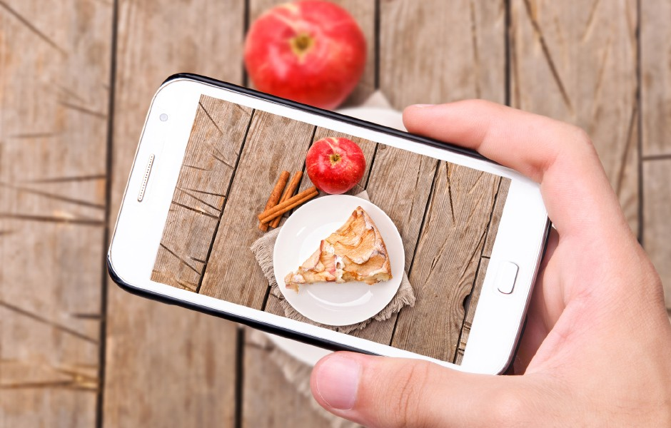 UGC Hands taking photo apple cake with smartphone