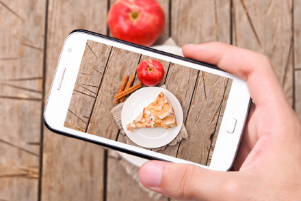 UGC hands taking photo apple cake with smartphone.png